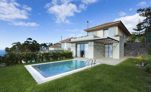 Villa con piscina privada climatizada en red level at gran for Casa con piscina tenerife